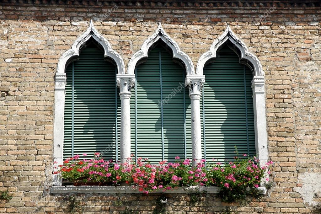 Venetian Style luxurious flowery balcony in venetian style with arched windows