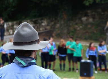 Chief scout with the typical Hat while controlling their kids to