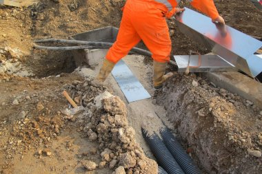 working with work overalls in the excavation