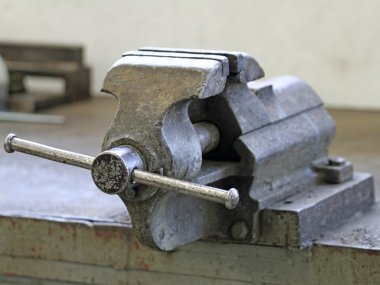 Workbench of a blacksmith in a mechanical workshop