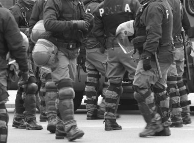 policemen in war planning during a control of supporters