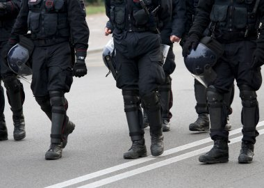 long black boots and helmets with protective screen