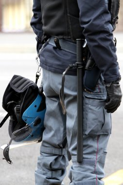 Policeman with truncheon, helmet gun and handcuffs