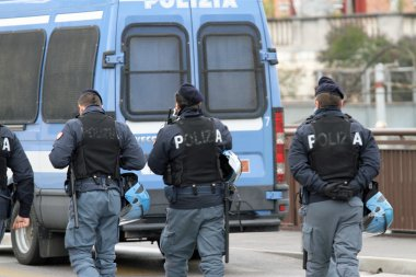 roadblock with a van with policemen during a raid against drug s
