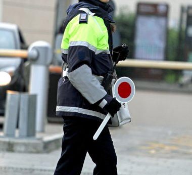 policewoman with the paddle while directing traffic