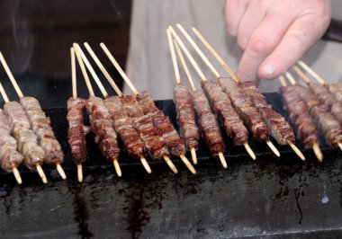 cow meat skewers roasted on glowing coals