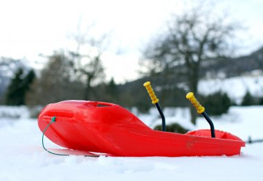 Red bob made of robust plastic on snow in the mountain