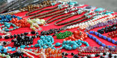 Fotografie a lots of jewelry and gemstone necklaces for sale at a jewelry s