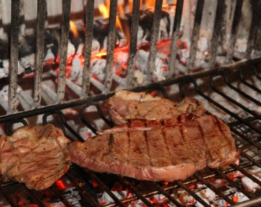 tasty and flavorful beef steaks cottain a fireplace