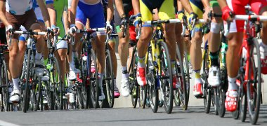 bicycle race with athletes engaged in road slope