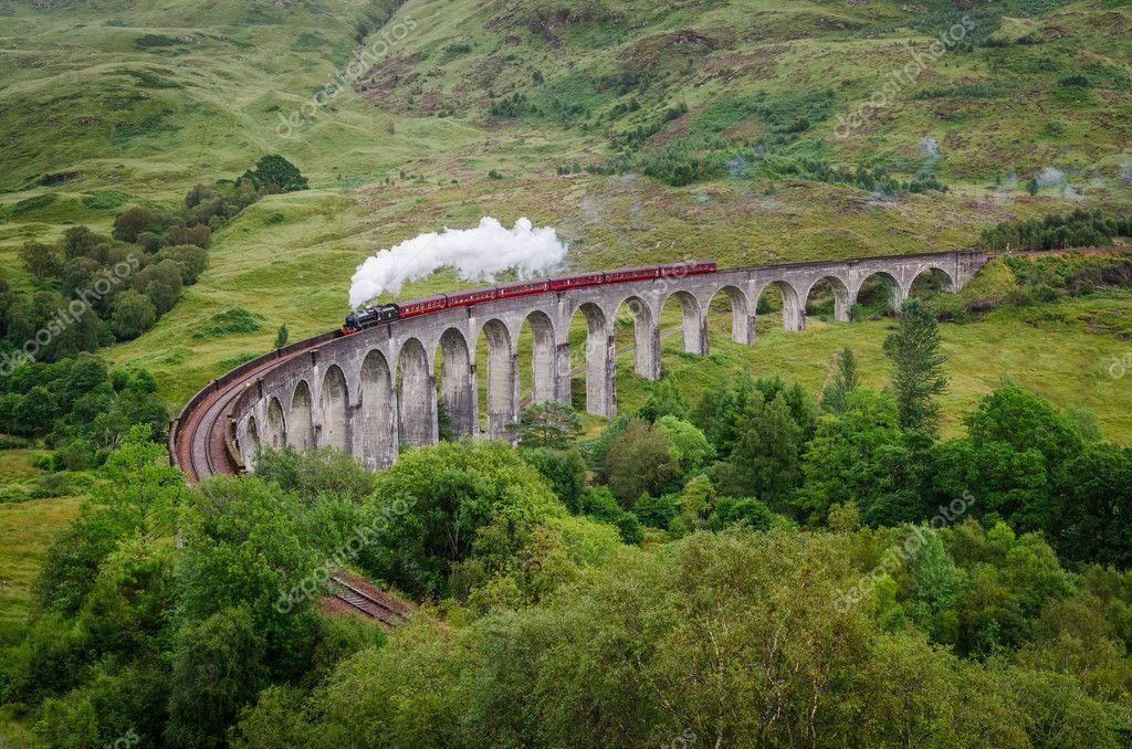 Steam train on a famous Glenfinnan viaduct, Scotland