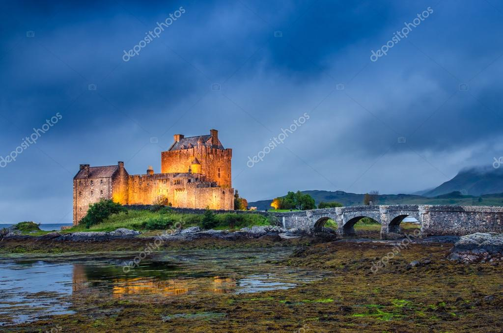 View of Eilean Donan castle at sunset in Scottish highlands