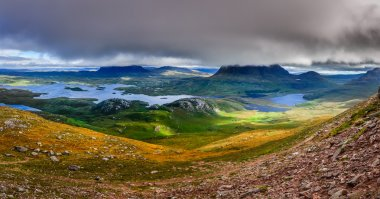 Panoramic view of Inverpolly mountains area in highlands of Scot