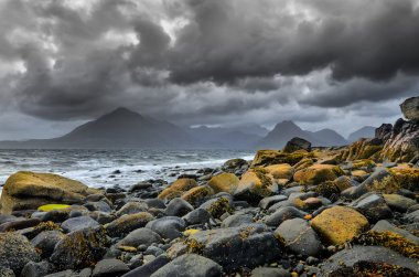 Landscape coastline view of rocks and Cullin hills, Scotland