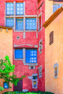 Detail of nice colorful wall with doors and windows, Sardinia