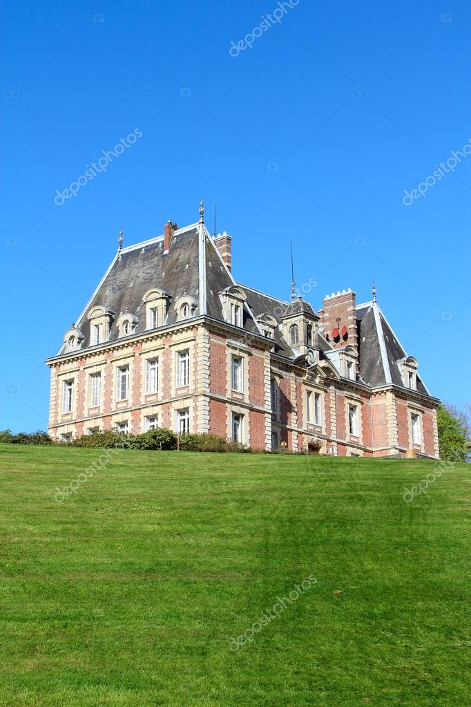 Old Mansion On Green Hill Stock Photo