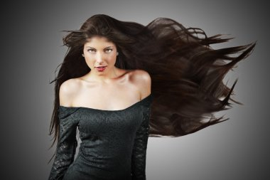 Portrait of teen girl with beautiful long brown healthy hair and vivid make