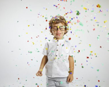 Beautiful child with rimmed glasses and confetti