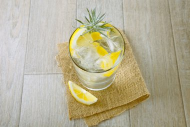Glass of gin and tonic with ice and lemon