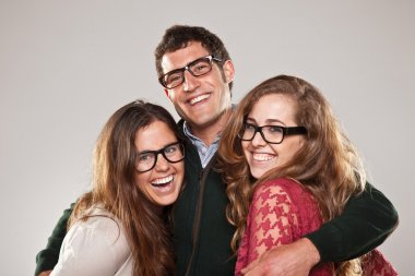 Three smart student friends looking with eyeglasses