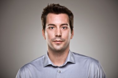 Portrait of a normal man over grey background