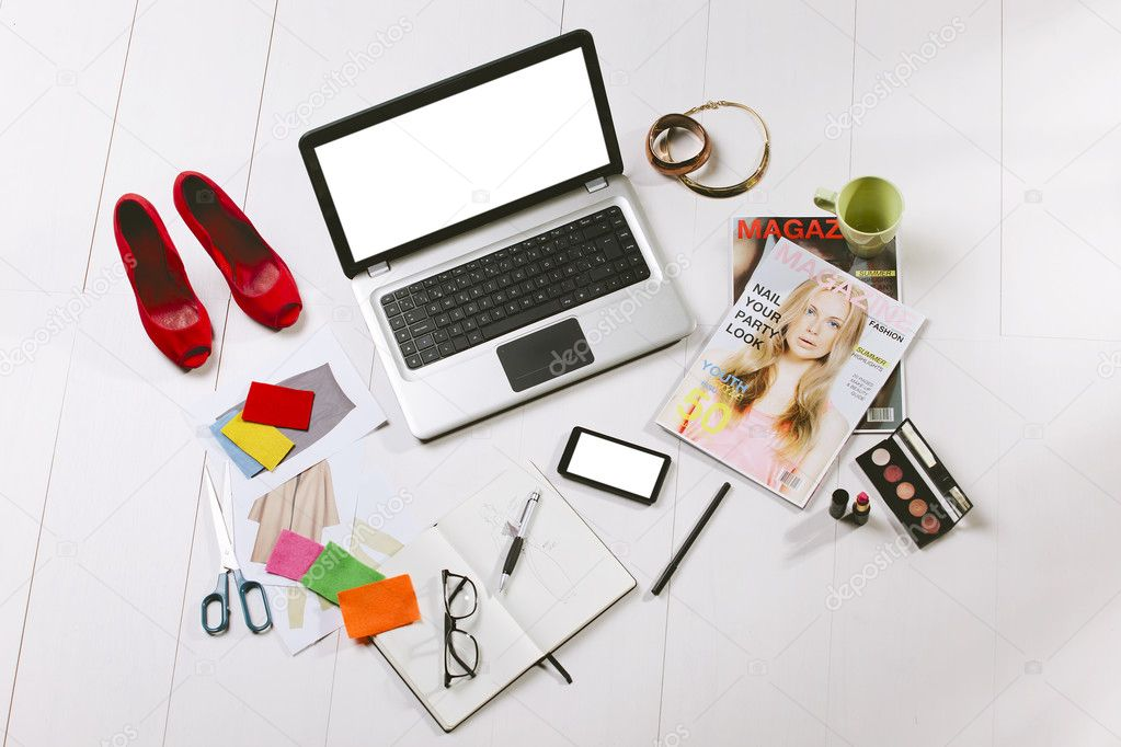 Overhead of a essentials objects in a fashion blogger