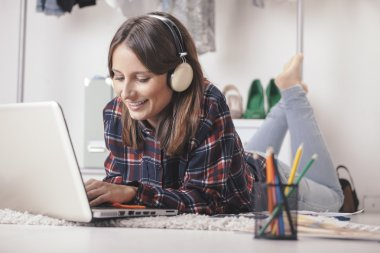 Casual blogger woman working with laptop in her fashion office.