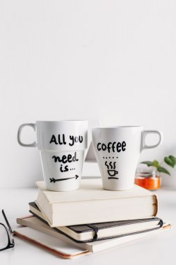 Two white coffee mug with diy decoration.