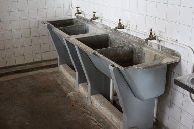 Washbasins at Robben Island Prison