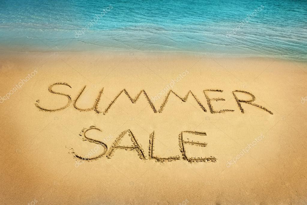 Summer sale letters on sand