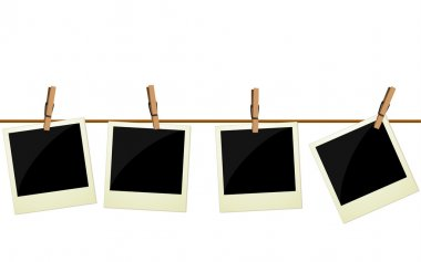 Four polaroid pictures hanging on rope