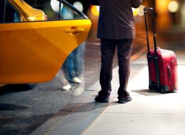 Masn catching a taxi
