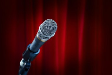 Microphoneon red curtain