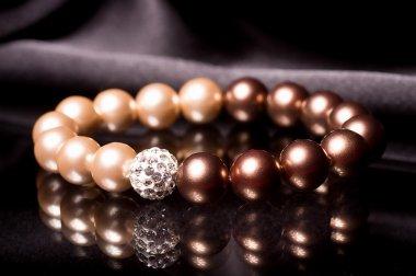 Pearl bracelet over black velvet