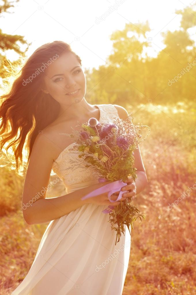 Bride with flowers in dress