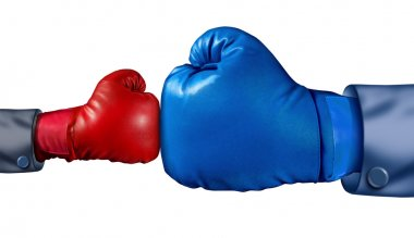 Competition and adversity and fighting the establishment as a new small business against a huge established corporation as a smaller boxing glove versus a huge one a stock vector