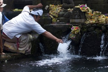 Man collects the holy water in bottle