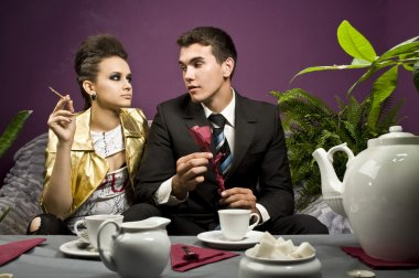 The man gives a self-made rose from a napkin to the girl