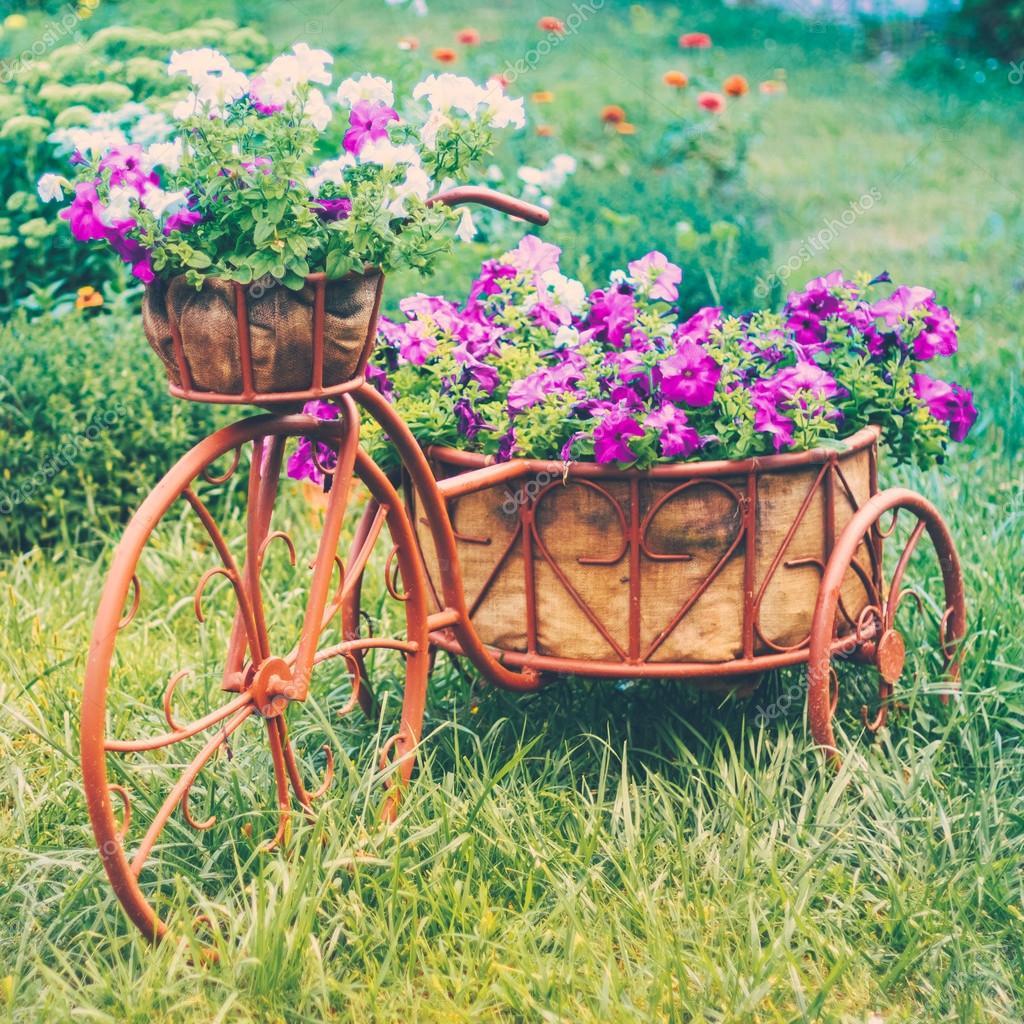 Decorative Bicycle In Garden — Stock Photo © Ryhor #44616481