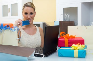 Happy smiling woman shopping online at home
