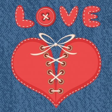 Love and laced heart with jeans background.