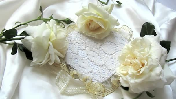 Three white roses and heart with love