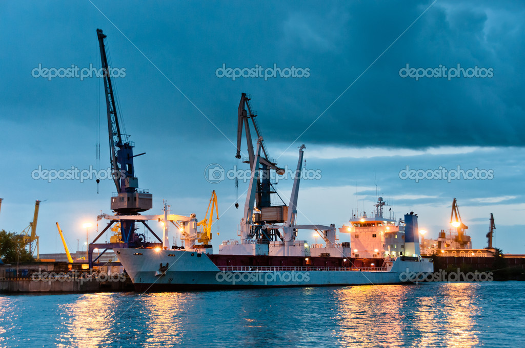 Shipyard with ship at dusk time