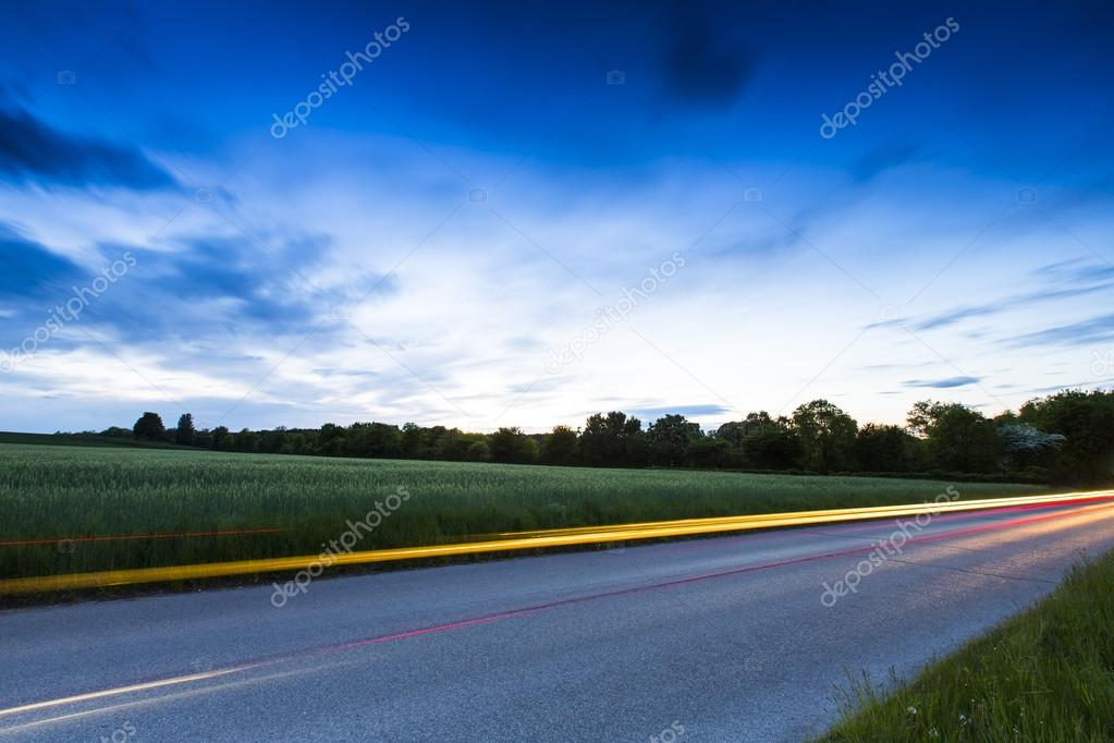 Long exposure highway blue hour sunset clouds sky road traffic autoroute