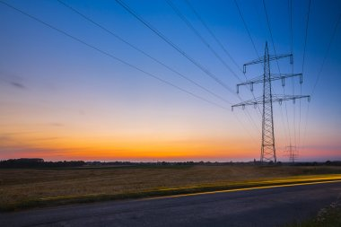 Power pole sunset long exposure high voltage electricity power energy dusk