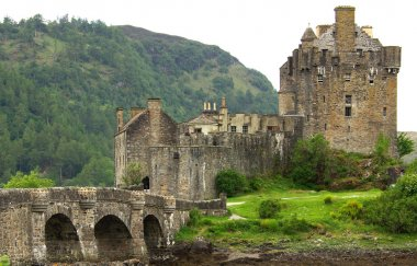 Castle Eilean Donan in Scotland in summer day stock vector