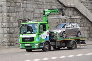 Moscow, russia, June, 12, 2014. Russian scene: The tow truck while working in Moscow