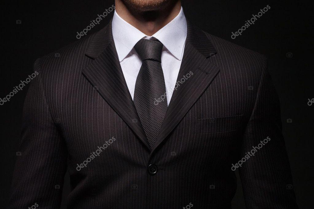 businessman standing on dark background