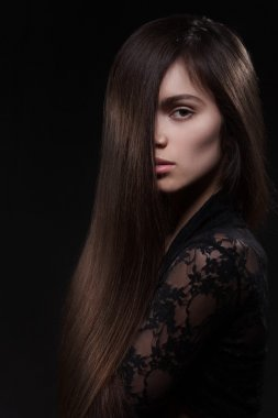 Pretty woman with long straight hair