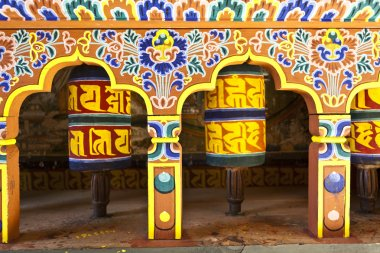 Colorful prayer wheels in Bhutan